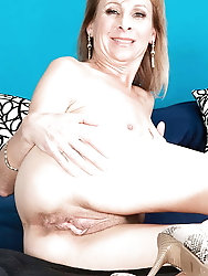 Lovely mature milf in sexy clothes