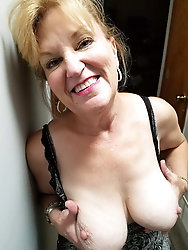 Elegant-looking mature bitch is masturbating herself
