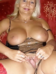 Smiling mature MILFs are fingering themselves