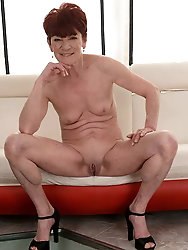 Lusty granny with big flabby tits stripping and spreading he